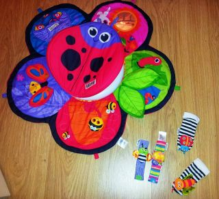 Lamaze Spin and Explore Tummy Time Prop Play Garden Gym Mat Wrist Feet